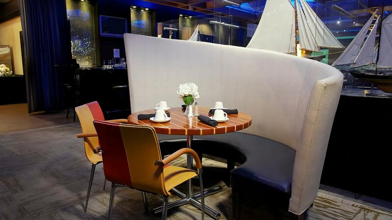Restaurant booth, table and two chairs.